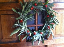 fresh sage and fire thorn wreath on the front door