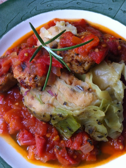 Stuffed Cabbage with Smoked Cheddar Mashers, Tempeh Italian Sausage and Roast Heirloom Tomato Sauce