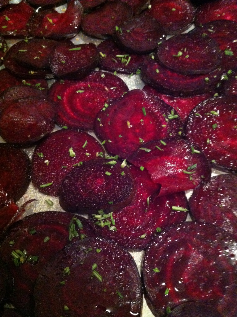 sprinkled with kosher salt and minced rosemary, the beets are ready for the oven