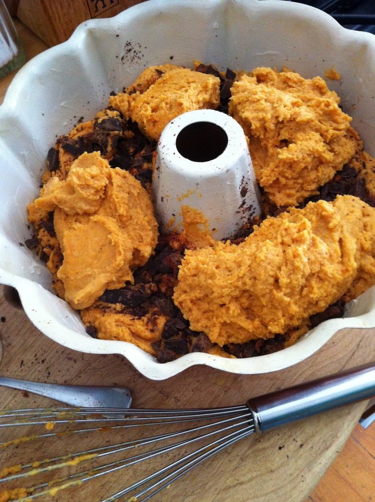 layering the pumpkiny, coconutty batter and filling