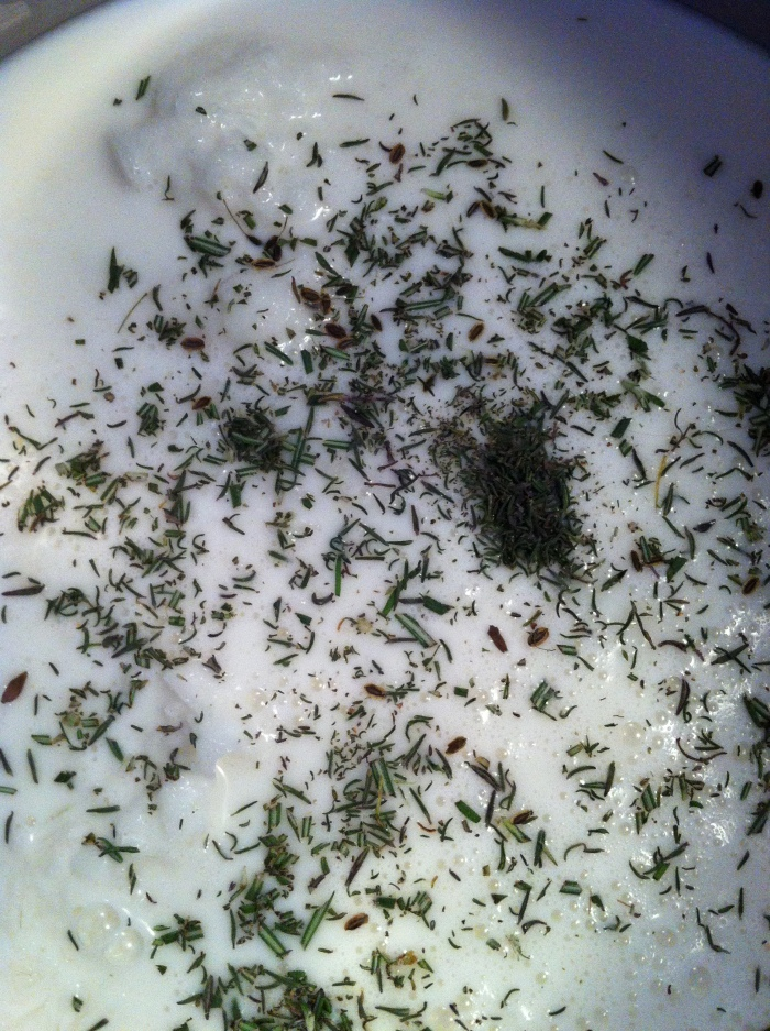 milk and herbs in the pot