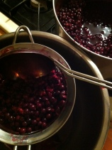straining the elderberry juice