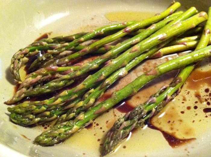 marinating asparagus in balsamic vinegar and olive oil