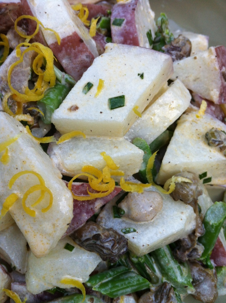 The luscious potato salad studded with rich smoked oysters