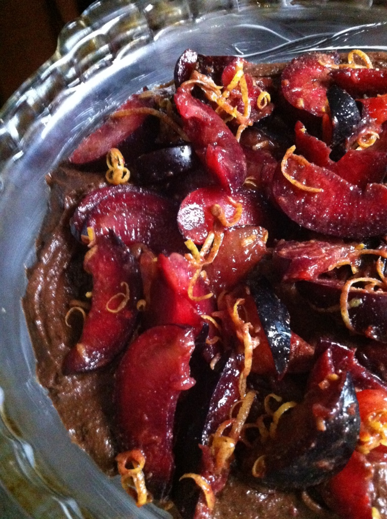 spiced lemony plums atop the batter