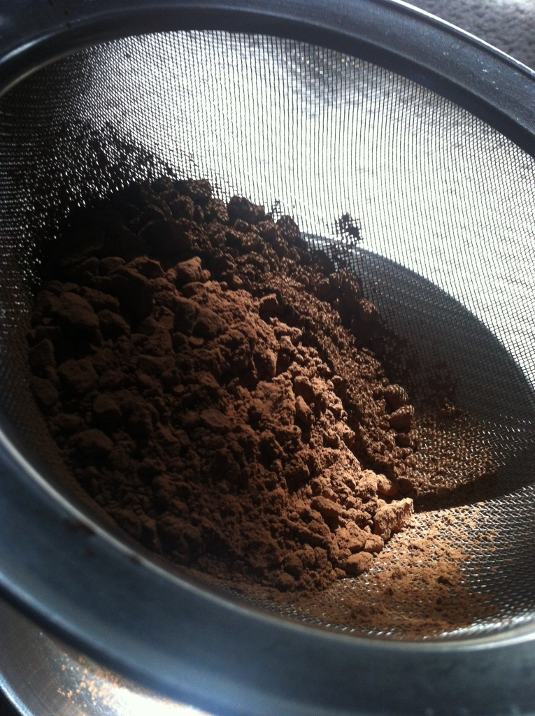 sifting the  cocoa..