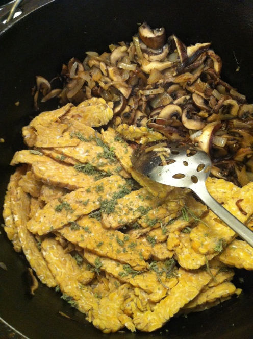 adding the tempeh and herbs