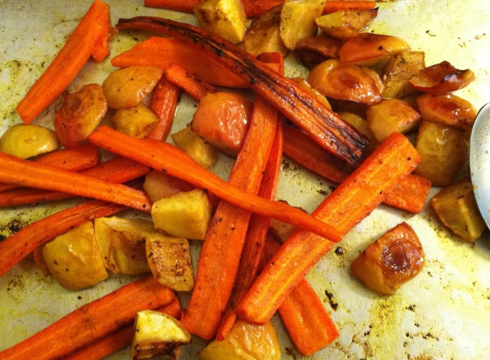 the captivating fragrance of coconut oil and curry roast carrots and apples