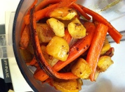 the roasted apples and carrots are placed into the food processor