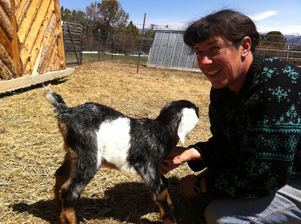 my friend Jeanne and one of her 2 day old goats (now nearly 1 year old!)