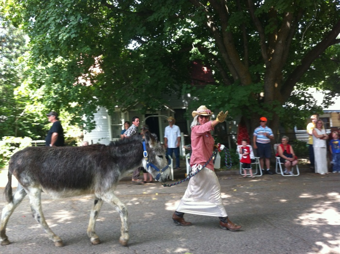 It's Marla and her burro friend, cruising towards the park, Cherry Days parade