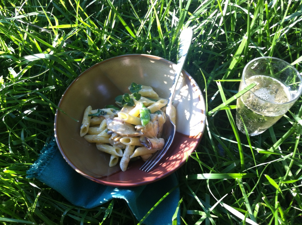 the finished dish, out by the garden with a glass of champagne