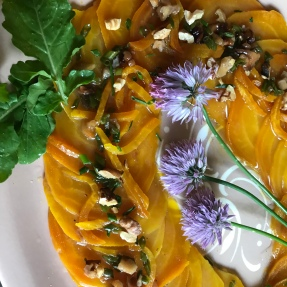 Golden beet carpaccio with walnut sherry vinaigrette and chives